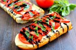 This Toasted Caprese Garlic Bread is made with hints of garlic and topped with ripe tomatoes, fresh basil, and creamy mozzarella cheese!