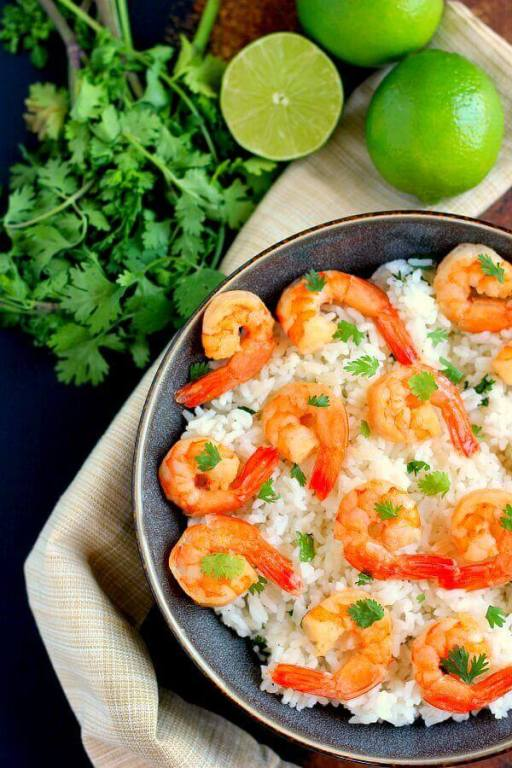 This Honey Garlic Shrimp and Cilantro Lime Rice Bowl is packed with tender shrimp, seasoned with a sweet honey garlic sauce and nestled on top of zesty cilantro lime rice. It's ready in less than 30 minutes and bursting with flavor!