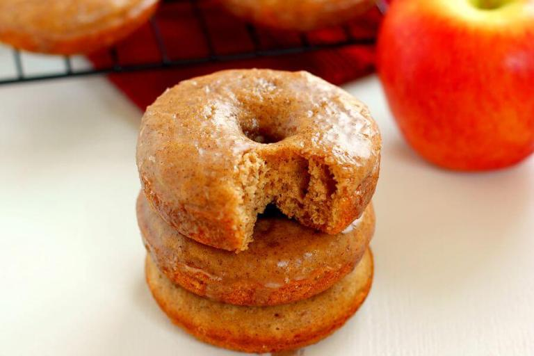 These Cinnamon Vanilla Glazed Apple Cider Donuts are baked to perfection with hints of fall spices and sweet apple cider.Covered in a vanilla glaze that's sweetened with cinnamon, these donuts are easy to make and the perfect treat for fall! #donuts #donutrecipe #applecider #appleciderdonuts #appledonuts #appledonutrecipe #appleciderdonutrecipe #applerecipe #fallrecipe #falldessert #falldonuts #dessert #fallbreakfast