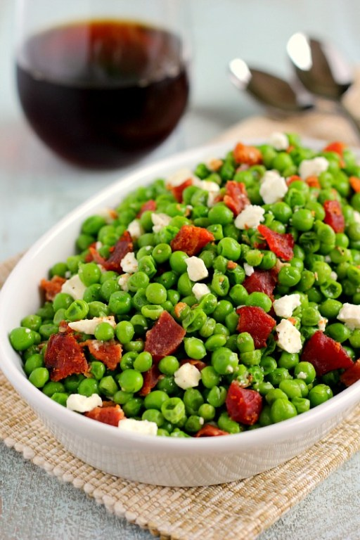 These Bacon and Feta Peas are seasoned with a buttery garlic sauced and packed with crumbled bacon and creamy feta cheese. It's an easy side dish that takes just minutes to make and is sure to be a favorite in your household!