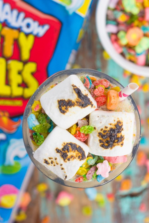 This Toasted Marshmallow Fruity Pebble Milkshake is loaded with creamy vanilla ice cream, a swirl of cereal, and topped with toasted marshmallows. With just four ingredients and hardly any prep time, you can indulge in this delicious frozen treat to beat the summer heat!