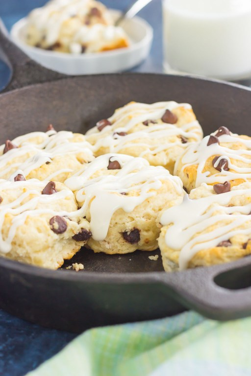 These Chocolate Chip Biscuits are light, fluffy, and filled with sweet chocolate chips. Easy to make and ready in less than 30 minutes, this simple dish is perfect for breakfast or dessert! #biscuits #chocolatechip #chocolatechipbiscuits #biscuitrecipe #breadrecipe #sidedish #breakfast