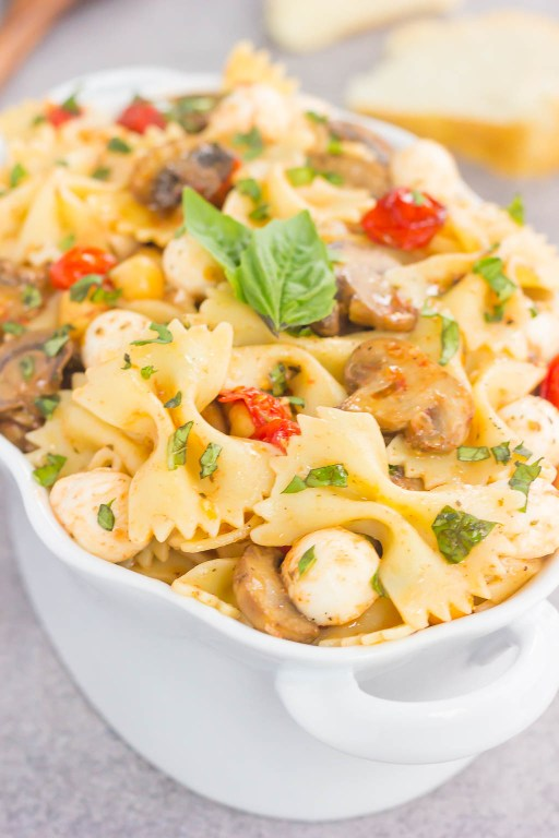 This Roasted Mushroom and Tomato Pasta Salad is a flavorful dish that comes together in minutes. Fresh mushrooms and cherry tomatoes are roasted until tender and then tossed with chickpeas, mozzarella and pasta in a light, white balsamic dressing! #pasta #pastasalad #tomato #tomatosalad #mushrooms #mushroompastasalad #pastasaladrecipe #saladrecipe #sidedish