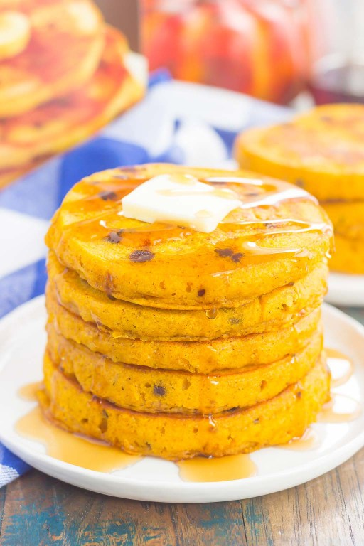 These Pumpkin Chocolate Chip Pancakes make a deliciously cozy breakfast for fall. Filled with sweet pumpkin and bursting with chocolate chips, these simple pancakes are soft, fluffy and so easy to make! #pancakes #pumpkinpancakes #chocolatechippancakes #pancakerecipe #breakfast