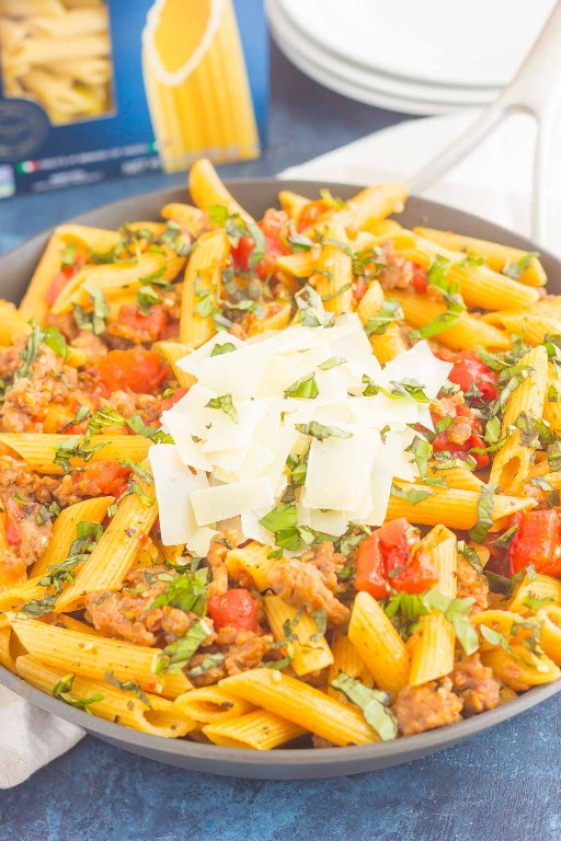 This Tomato Basil Pasta with Italian Sausage is an easy, one pan meal that's perfect for busy weeknights. Filled with tender pasta, Italian sausage, and tossed in a simple tomato basil sauce, this dish is ready in less than 30 minutes and will become a new dinnertime favorite!