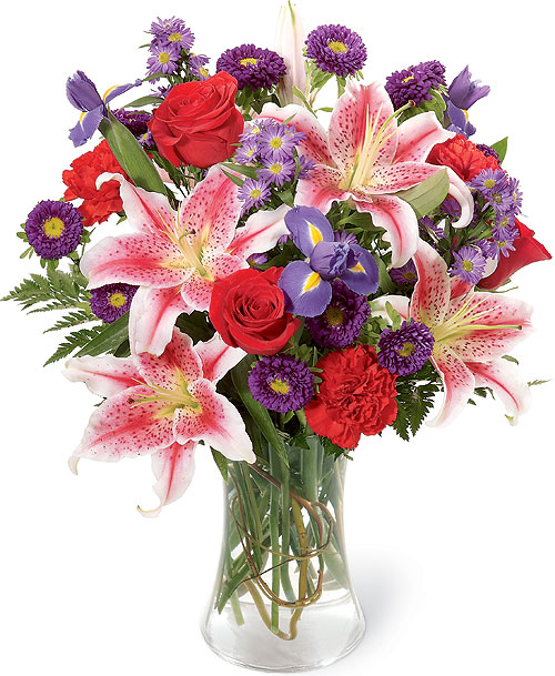 composizione con rose rosse iris blu e lilium