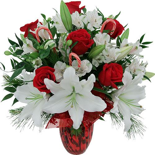 composizione con lilium bianchi fresie e rose rosse
