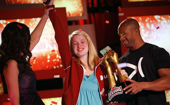 Winner Kate Moore, 15, of Des Moines, IA is congratulated during the National Texting Championship in New York June 16, 2009. The winner, crowned from an initial group of 22 qualifiers who competed in a series of events over two days to test their texting speed, dexterity, nerves, athleticism and knowledge, receives $50,000. REUTERS/Eric Thayer (UNITED STATES ENTERTAINMENT)