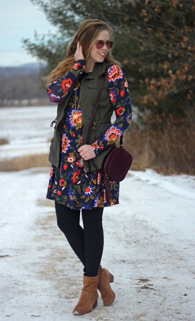 Floral Dress and Utility Vest: Old Navy swing dress in winter floral, green utility vest, black leggings, brown booties, maroon purse, Julie Vos pendant | Puppies & Pretties