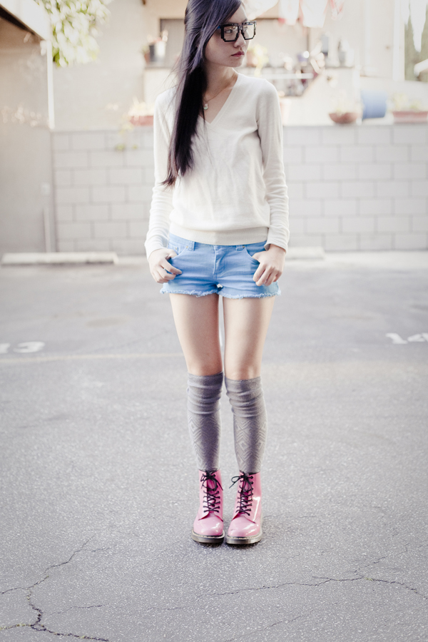 Uniqlo cashmere, Forever21 denim shorts, Dr. Martens hot pink lamper boots, geek glasses.