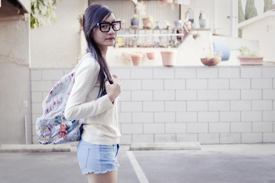 Uniqlo cashmere, Forever21 denim shorts, Dr. Martens hot pink lamper boots, geek glasses.