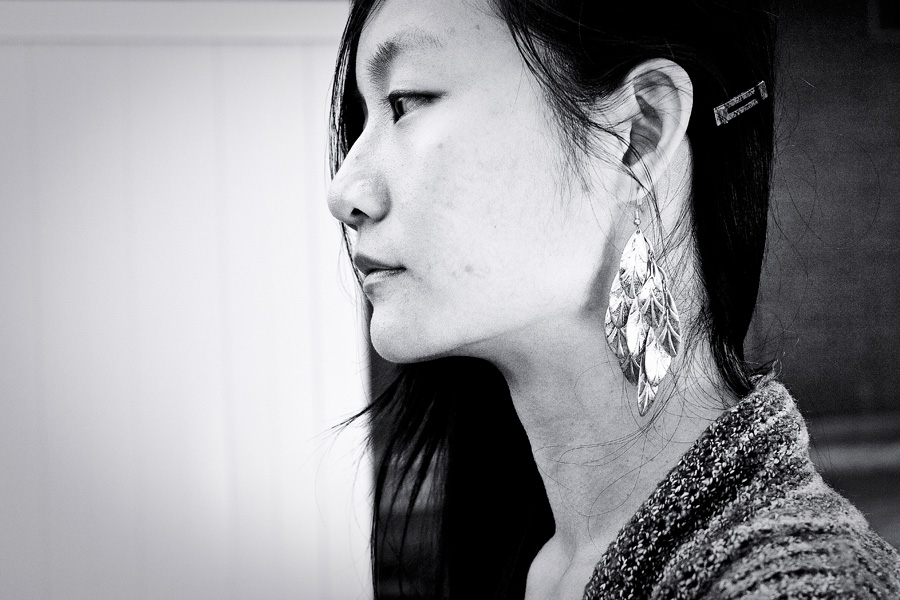 Close-up of gold H&M tiered leaves earrings.