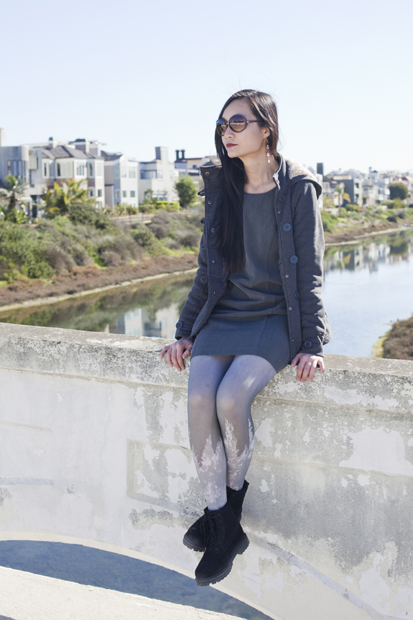 Sitting on a bridge at Balloona Creek in Marina Del Rey, Los Angeles.