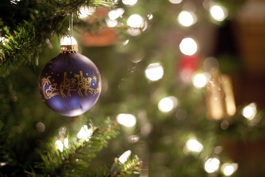 Close-up of a bauble decorating a christmas tree.