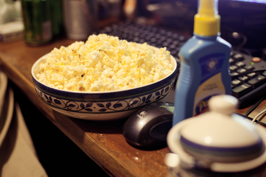 Microwavable popcorn ready to be spritzed with butter and sprinkled with sugar.