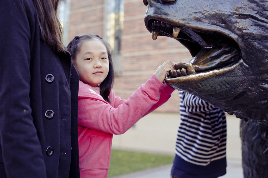Girl posing with the Bruin bear mascot in UCLA.