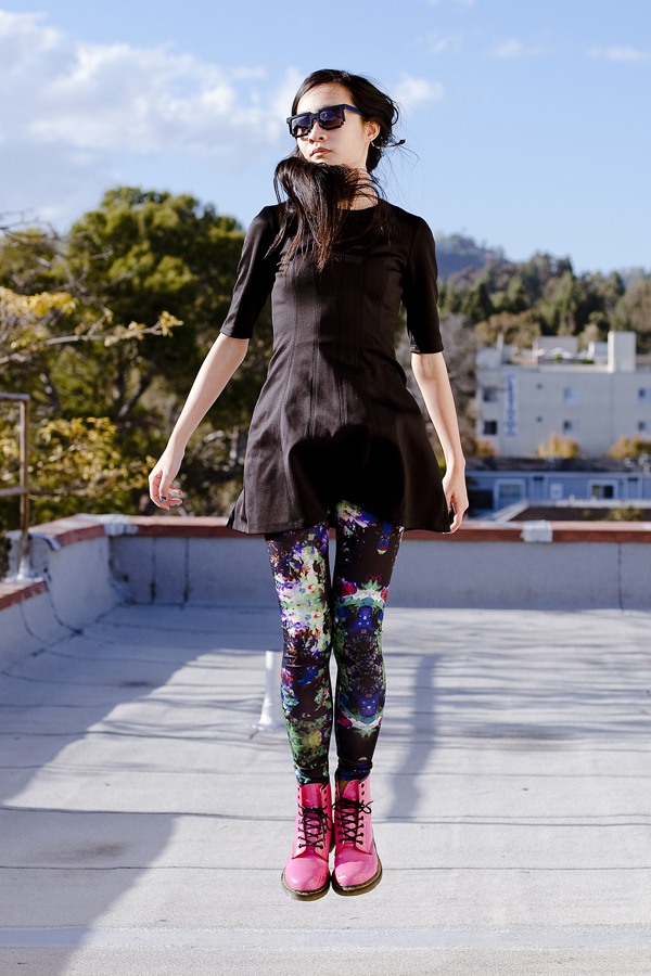 Self-portrait in levitation. rabbit nose mask. wearing Forever 21 little black dress, 8 bit geek sunglasses, H&M abstract colourful leggings, hot pink lamper 1460 8 eye dr martens, H&M gold feather earring.