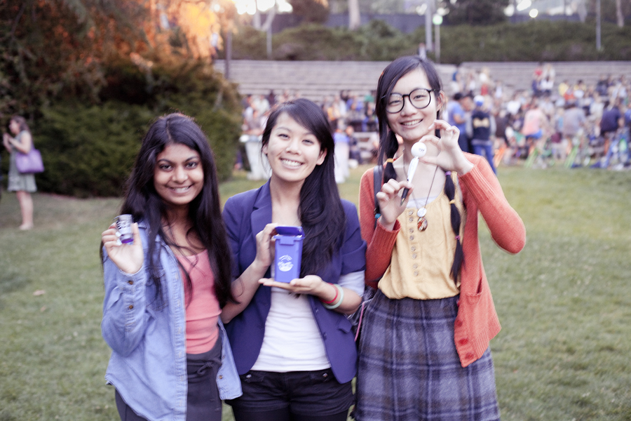Nam, Lilli and Ren with souvenirs and prizes at Ecochella in UCLA.