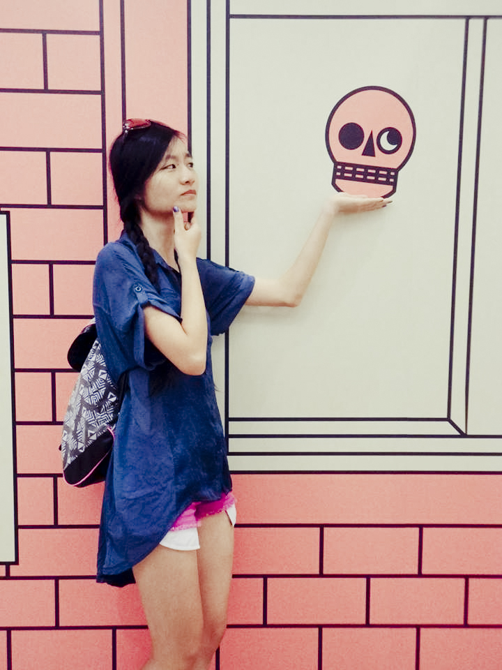 Ren posing with a skull on the wall.