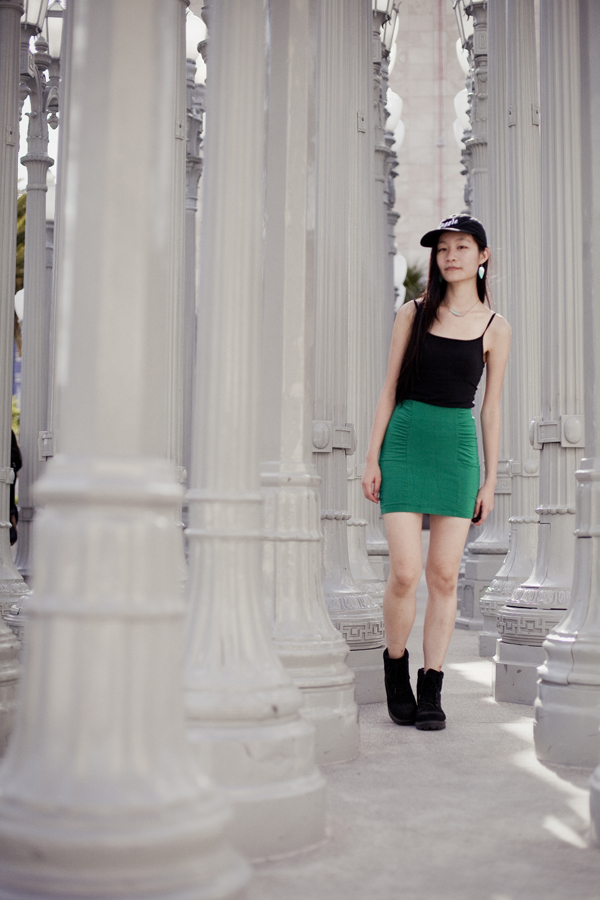 OOTD at LACMA wearing: Uniqlo black bratop camisole, Forever21 green bandage skirt, Fila black men's boots, Harry Potter Muggle cap, Forever21 mint turquoise necklace and leaf earrings.