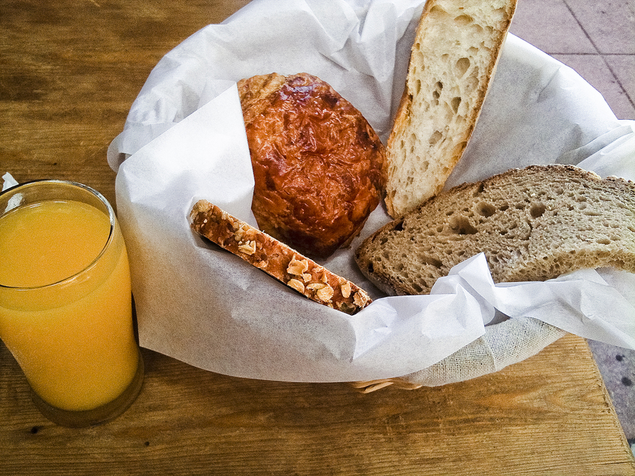 Nam's bread basket comes with orange juice and hot chocolate at Le Pain Quotidien at Westwood, Los Angeles.