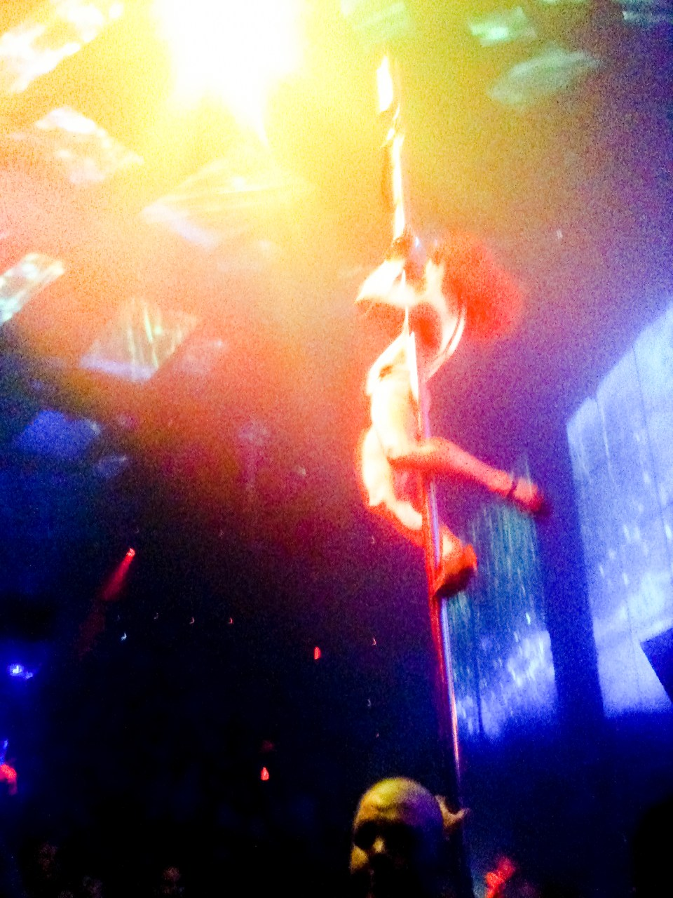 Cirque Du Soleil acrobats above the dancefloor of Light nightclub in Las Vegas.