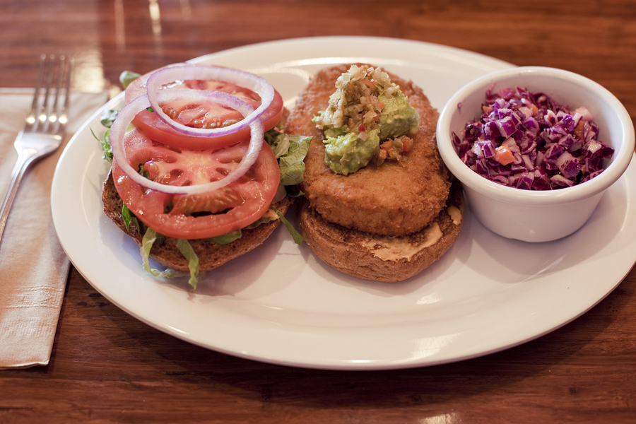 Santa Fe Chicken Sandwich with a side of coleslaw at Veggie Grill in Westwood, Los Angeles.