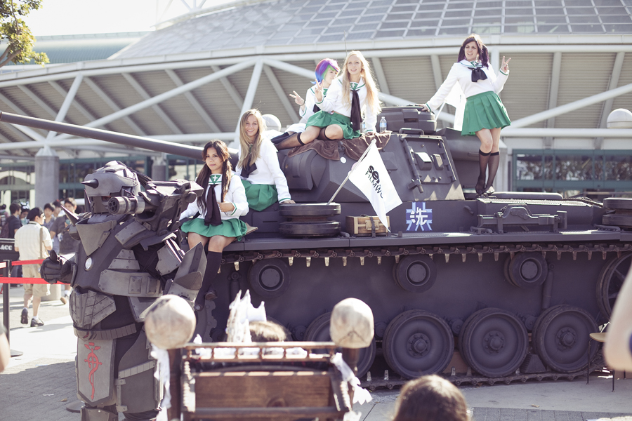 Cosplayers on a tank at Anime Expo 2013.