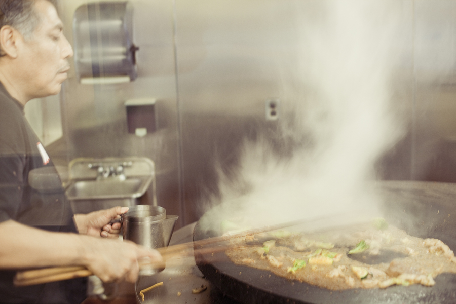 Staff frying the ingredients at Mongols bbq in Westwood.