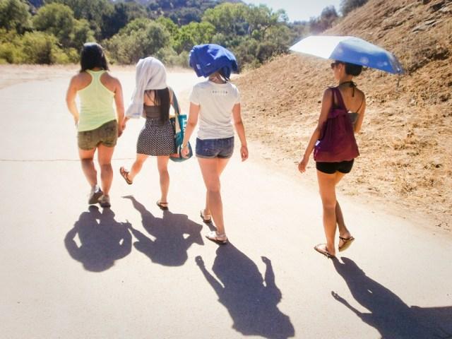 Girls avoiding the sun on the hike at Malibu Creek.