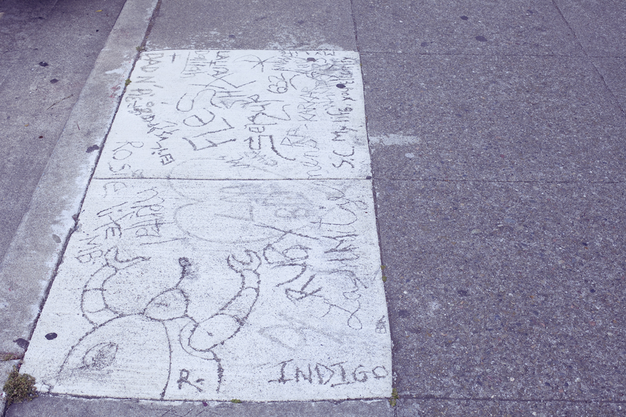 Drawing on a slab of pavement on Haight in San Francisco.