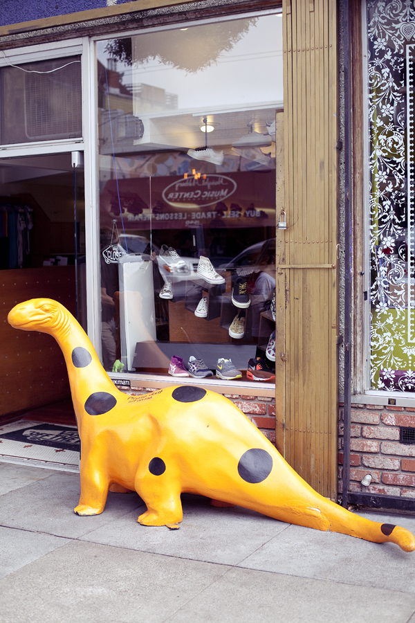 Spotted dinosaur on display outside a store on Haight in San Francisco.