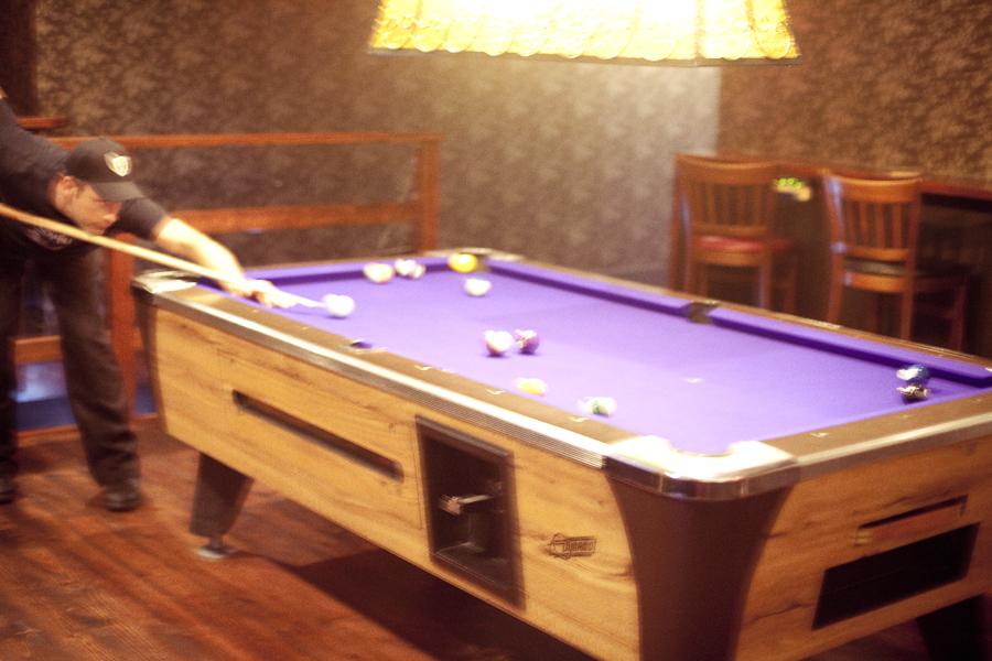 Purple felt-lined pool table at Emperor Norton's Boozeland in San Francisco.