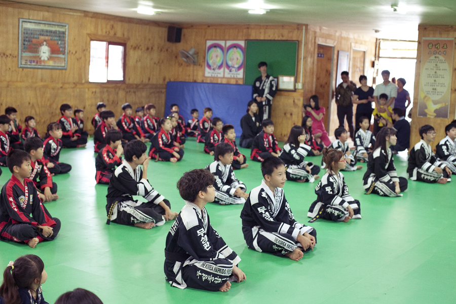 Kids warming up for belt test at Hapkido.