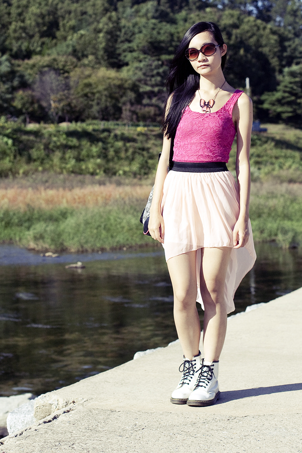 Outfit of the day: Urban Outfitters hot pink lace top, pastel pink chiffon high-low skirt, white Dr. Martens classic 1460 boots, La Marelle pink metal bow necklace.