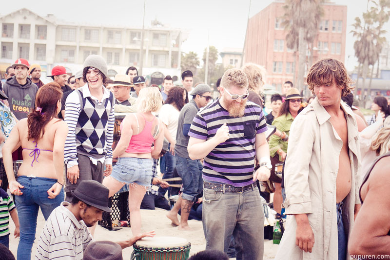 Dancers in a drum circle at Venice beach, Los Angeles.