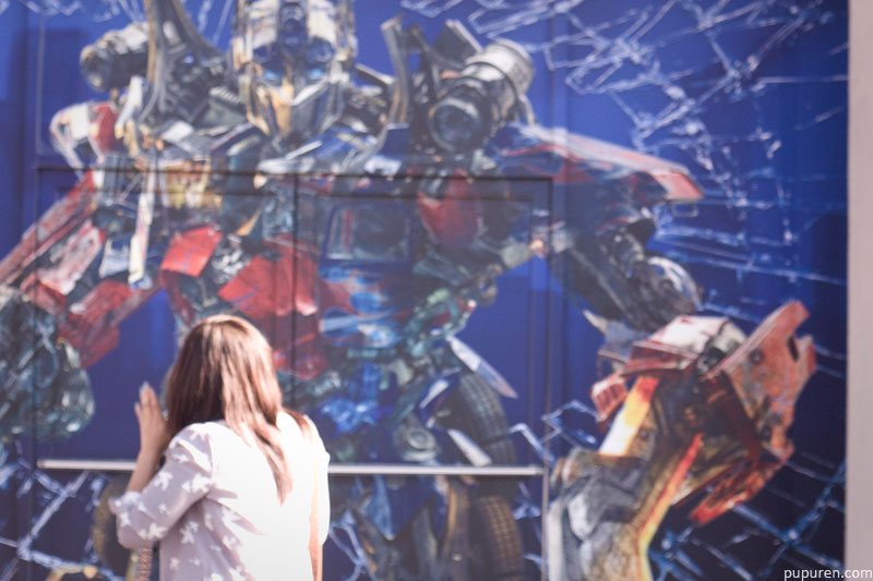 Jesca in front of a wall painted with Transformers in Hollywood, Los Angeles.