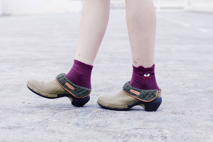 Kiki Socks maroon bear socks and Merrell knit luxe leather clogs.