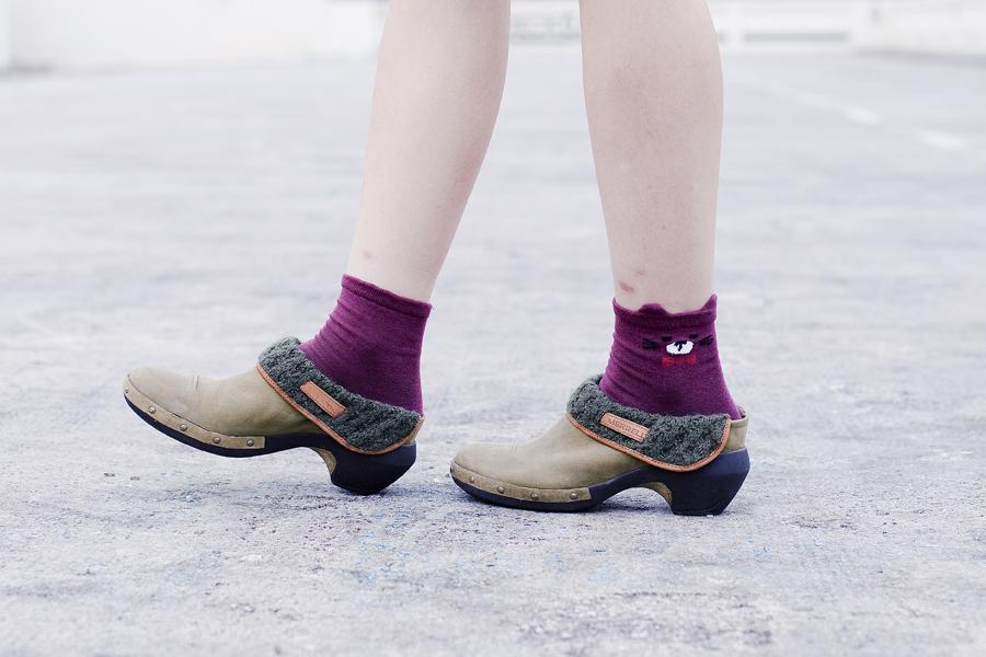 Kiki Socks maroon bear socks and Merrell knit luxe leather clogs.