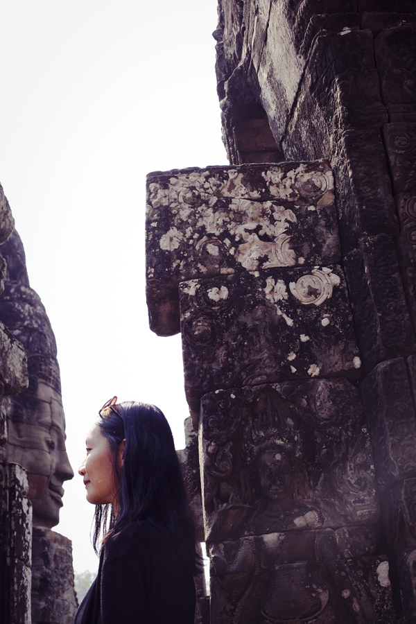 Ren coming nose-to-nose with a face at Bayon in Angkor Thom, Cambodia.