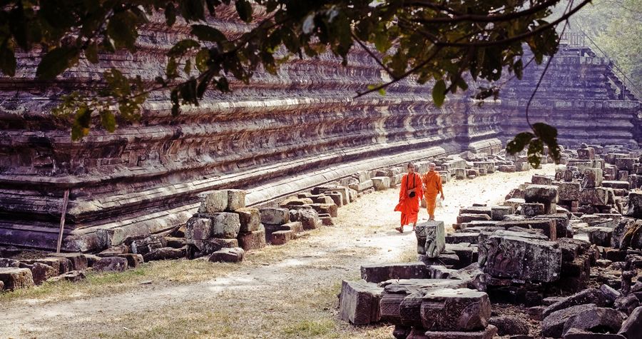 Two monks walking along Baphuon in Angkor Thom, Cambodia.