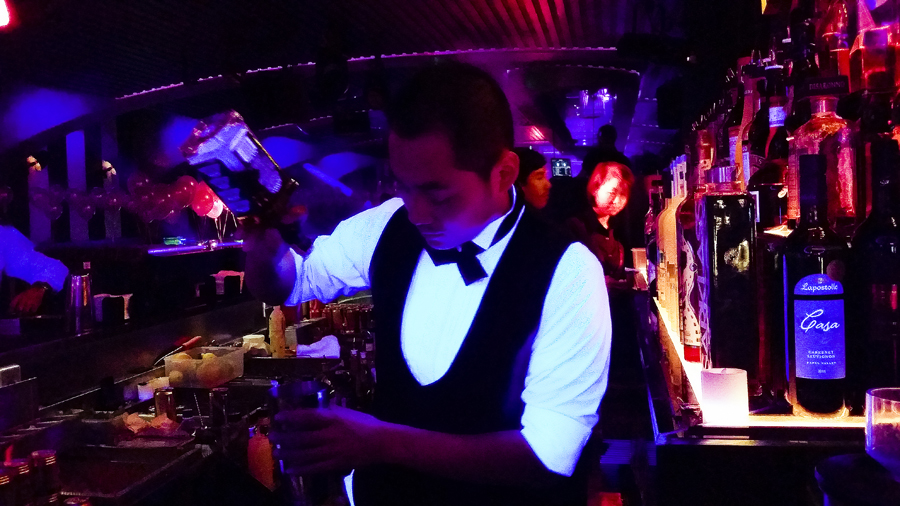 Bartenders at Cirque le Soir nightclub in Shanghai.