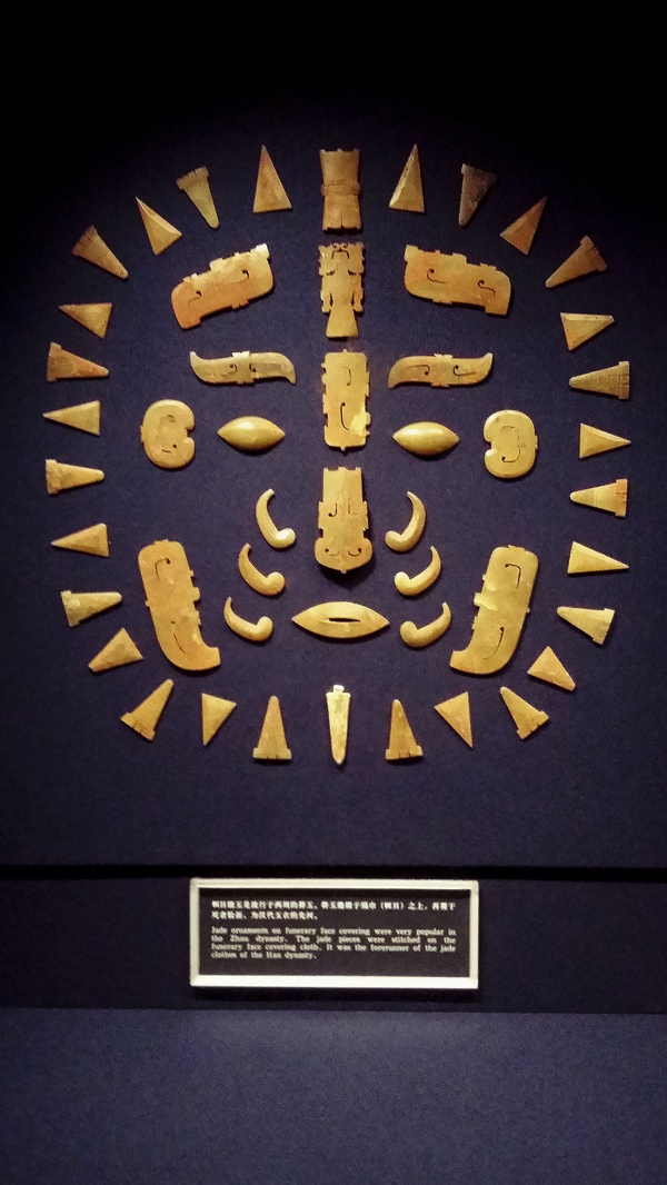 Ornaments on a funerary face covering from the late western Zhou dynasty (first half of 9th century - 771 BC) at the Shanghai Museum.