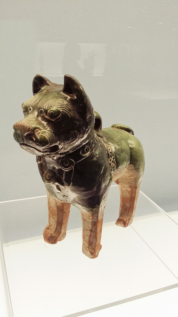 Green glazed pottery dog from the eastern Han Dynasty (25-220 AD) at the Shanghai Museum.