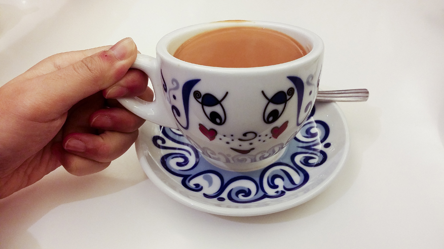 Milk tea in a cute tea cup at Cui Hua Restaurant in Shanghai.