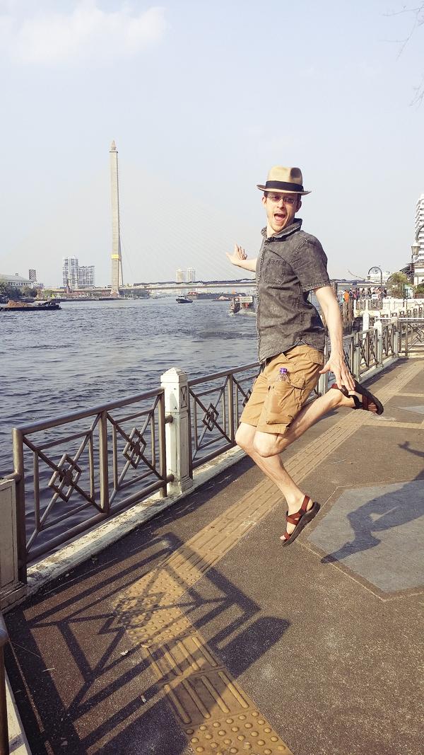 Ottie jumping by Chao Phraya in Bangkok, Thailand.
