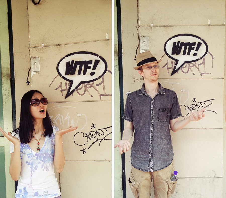 Ren and Ottie posing with a 'WTF!' graffiti in Bangkok, Thailand.