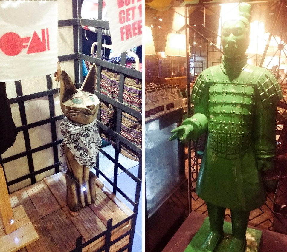 Cat display and green terracotta warrior in Terminal 21 in Bangkok, Thailand.