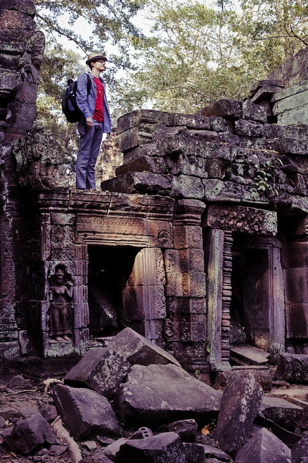 Ottie standing on top of the ruins at Ta Prohm, Cambodia.