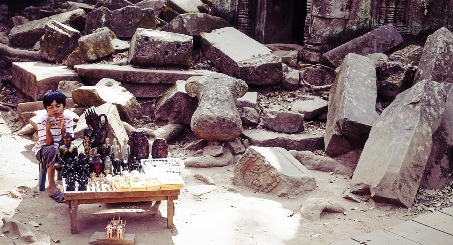 Kid selling souvenirs at Ta Prohm, Cambodia.
